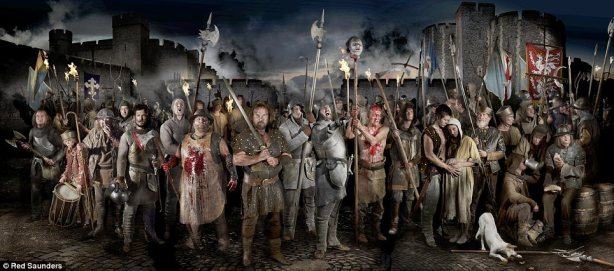 A perhaps over-grisly photographic reconstruction of a mob of revolutionaries gathering near the Tower of London, with Wat Tyler at front wielding a large two-handed sword.