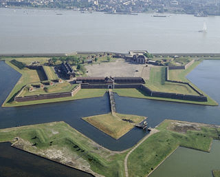 Aerial view of the Fort, courtesy of English Heritage. The 'ravelin' can be seen as the triangular island front-most.