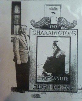 Mr. Henry Noakes with the new pub sign, the Licensee of the pub at the time