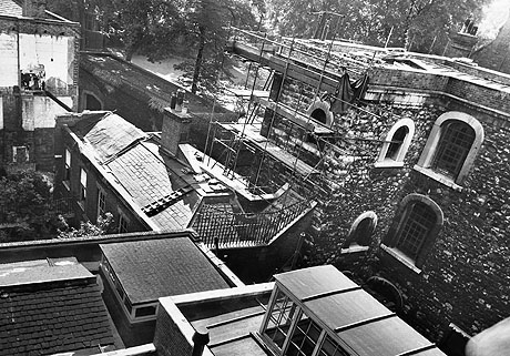 This photograph, courtesy of English Heritage, shows the tower cramped among many more modern buildings in September 1950. The tower was exposed when these buildings were demolished shortly after.