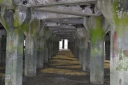 Under the construction jetty showing its pretty cool geometric design. Quite brutalist.
