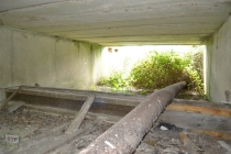 A pipe under the bridges that span over the ditches that would have gone between the bunded areas oil tanks