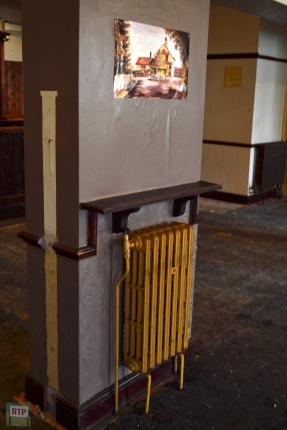 An old radiator with a photo/painting of the old building
