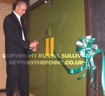 Dean Cutting Ribbon