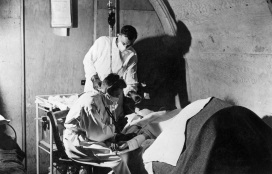 A patient being treated by doctors in the Underground Hospital.